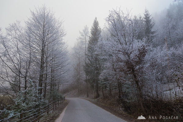 Frost and fog in the valley below Kamniški vrh hill
