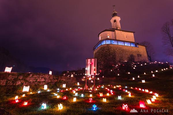 Lights around the Mali grad chapel in Kamnik at night