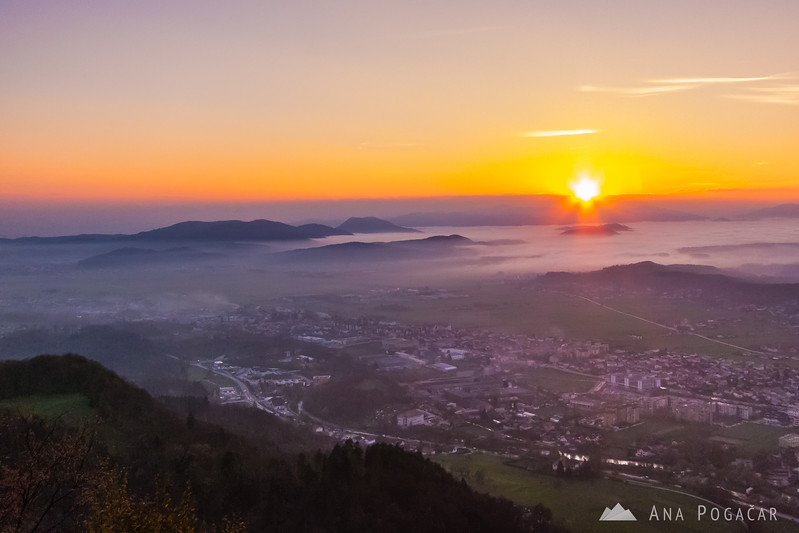 Views of Kamnik from Špica hill at sunset with mists in the valley