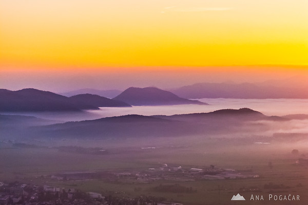 Views from Špica hill at sunset with mists in the valley