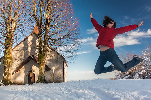 Ana jumping in the snow at Polževo