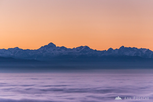 The Julian Alps from Špica hill above the fog after sunset