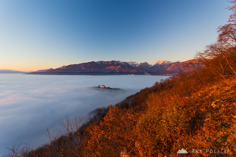 Stari grad and the Kamnik Alps from Špica hill above the fog