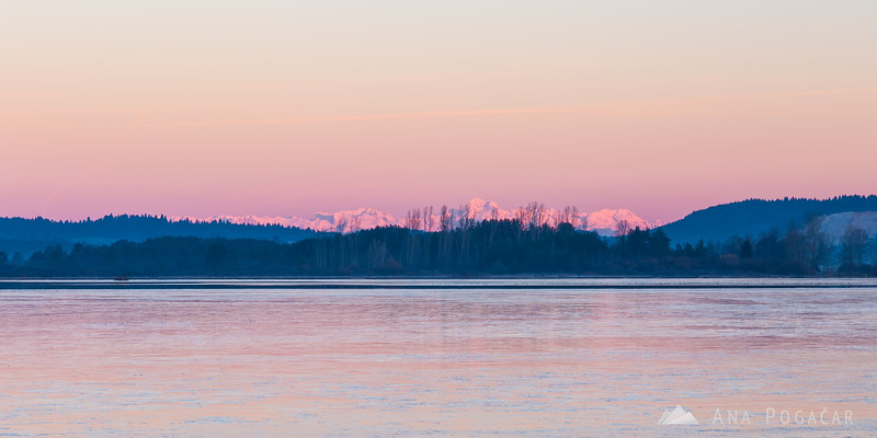 Sunrise at Lake Cerknica; pink Julian Alps