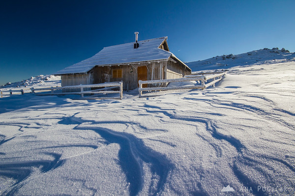 Typical Velika planina cottage in frost and snow