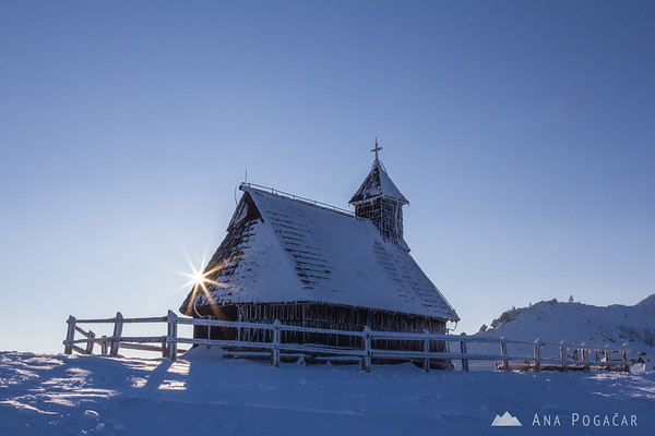 Sun burst at the Velika planina chapel