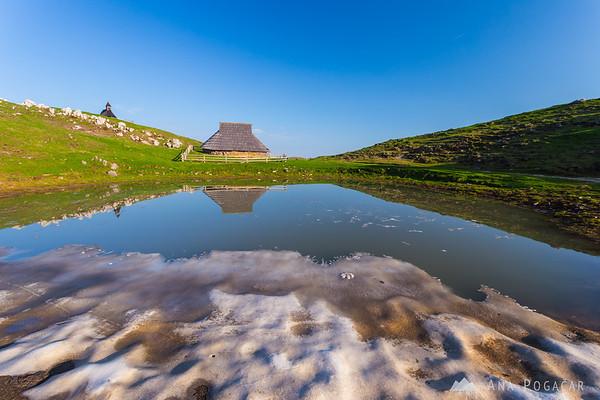 Snowy pond on Velika planina