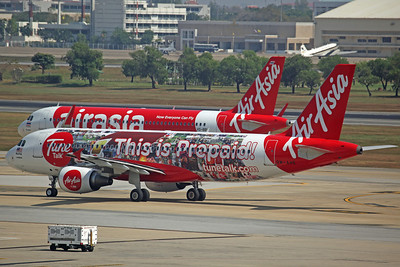 9M-AHE A320-200 Air Asia ('Tune Talk' logojet)