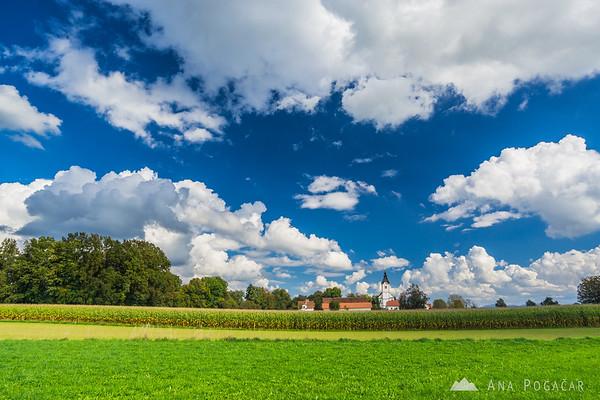 Biking around Kamnik through villages and across fields - the church in Komenda