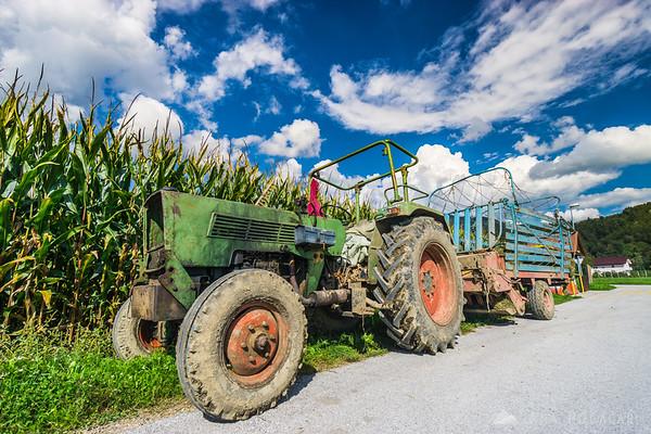 Biking around Kamnik through villages and across fields - an old tractor near Pšenična Polica