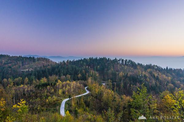 Fall colors below Špica hill at sunset