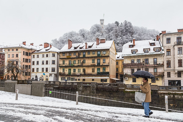 First snow in Ljubljana: Ljubljanica River and Ljubljana Castle