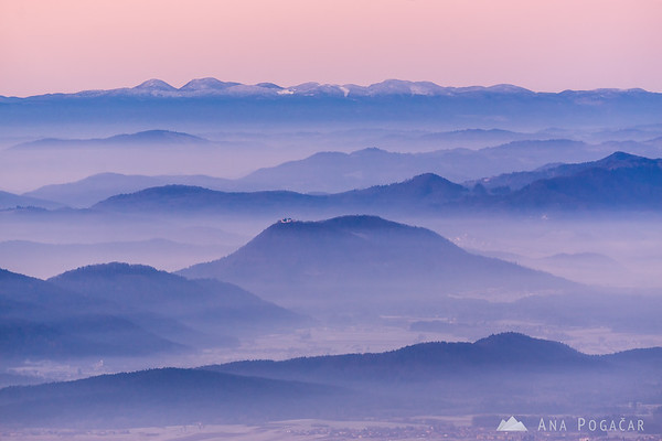 Before the sunrise on Kranjska Reber - looking at the layers of mists below. Šmarna gora in the middle
