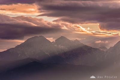 Morning sun rays from Križna gora