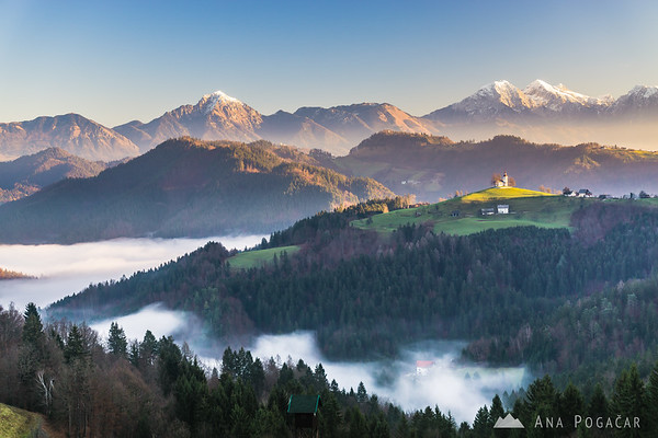 Winter morning with St. Tomaž church and the Kamnik Alps