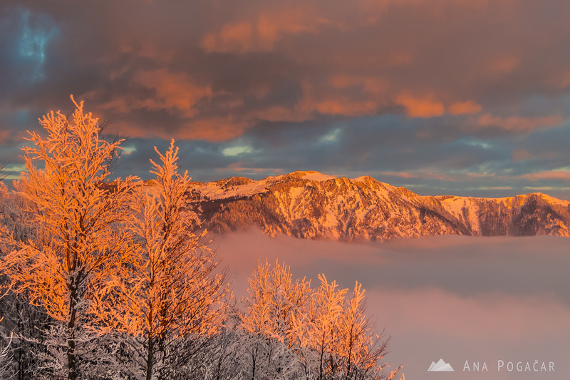 Crazy sunset colors and mists around Velika planina from Kamniški vrh