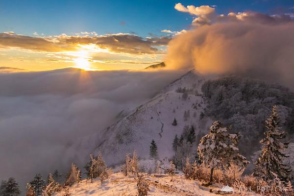 Sunset mists below the top of Kamniški vrh