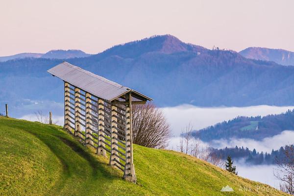 A hayrack at Rakitovec. Zasavska sveta gora in the background.