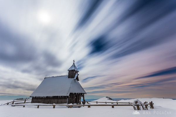 Long exposure of clouds and an occasional star on Velika planina at night