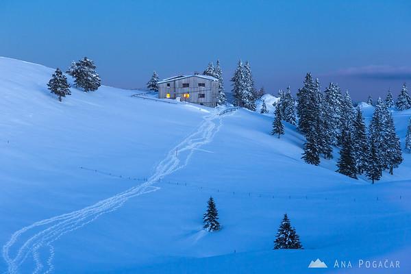Domžalski dom hut on Velika planina at dusk