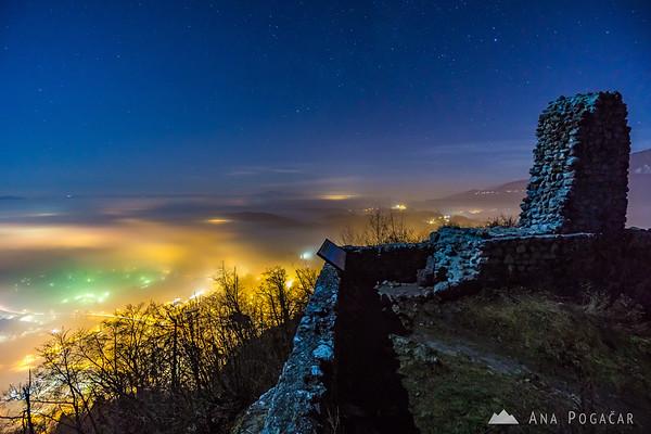 Foggy Kamnik from Stari grad hill at night