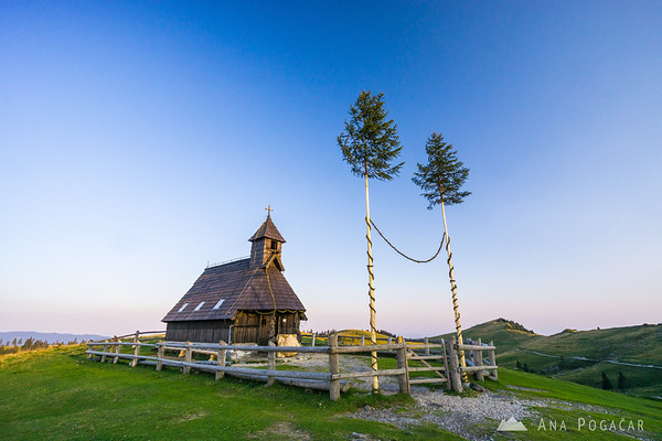 Chapel on Velika planina in late afternoon light