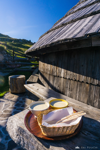 Eating delicious curdled milk at one of the shepherd's homes on Velika planina