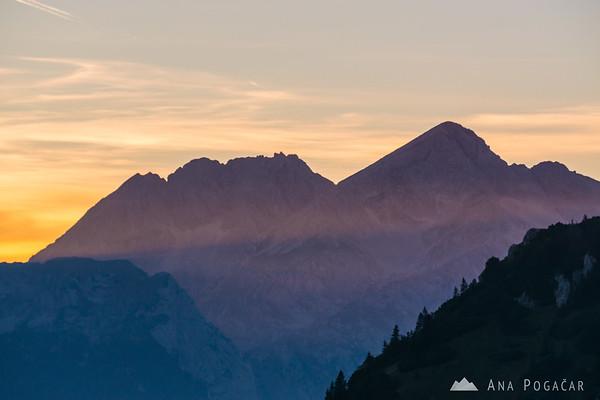 Mts. Kočna and Grintovec in last sun rays from Velika planina