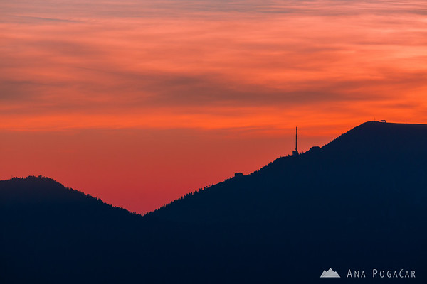 Krvavec at colorful sunset from Velika planina