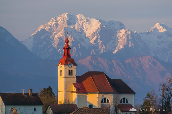 Church in Skaručna with the Kamnik Alps in the background