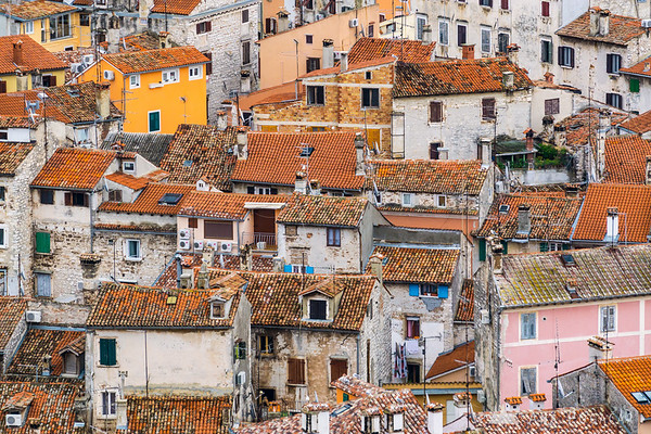 Red roofs from the church bell tower in Rovinj