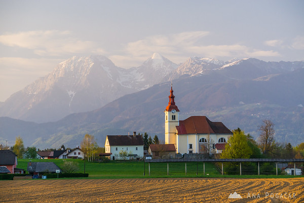 Church in Skaručna, with the Kamnik Alps in the background