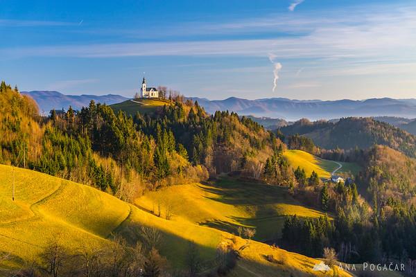 St. Lenart church from Črni vrh on a sunny winter afternoon