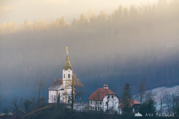 Church in Podlipa and late afternoon sun rays