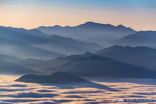 Sunset from Planina Jezerca - looking towards Kranj under the fog, Šmarjetna gora and Sv. Jošt.