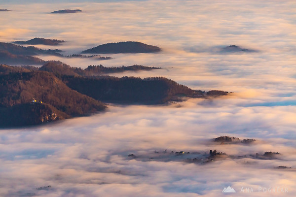 Sunset from Planina Jezerca - looking south towards Kamnik under the fog. Stari grad on the left.