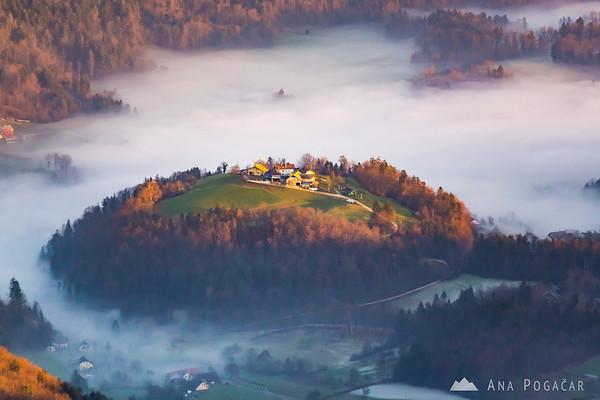 Sunset from Planina Jezerca - village of Kregarjevo above the fog.