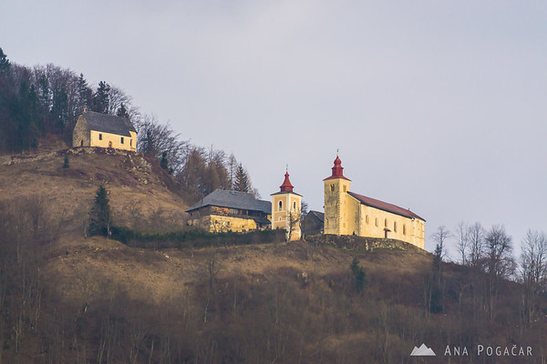 The churches of St. Primus and St. Peter from the trail.