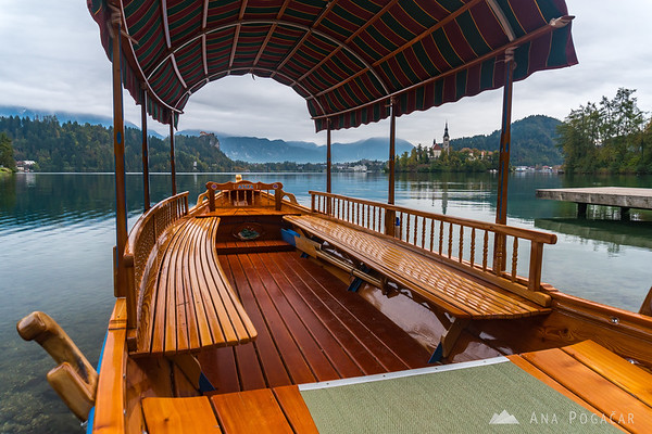 Pletna boat on Lake Bled on a cloudy morning
