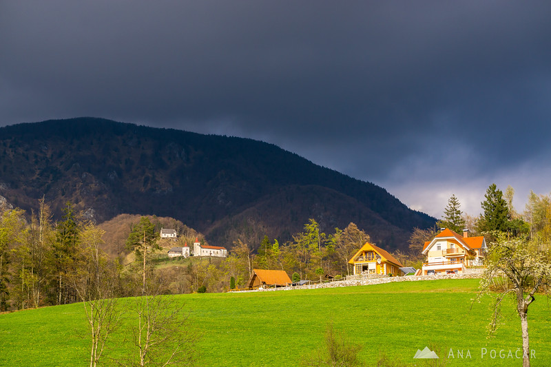 Dark clouds above St. Primož church from Brezje