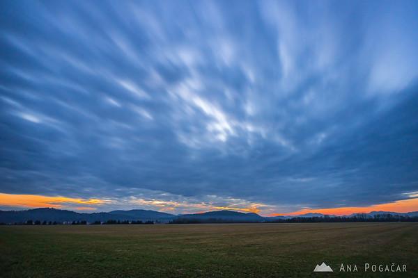 Clouds over Mengeš fields at sunset
