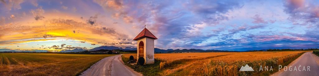 Phone panorama of a fiery sunset taken near Križ village