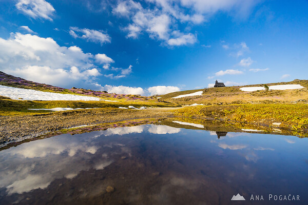 Reflection of the chapel on Velika planina