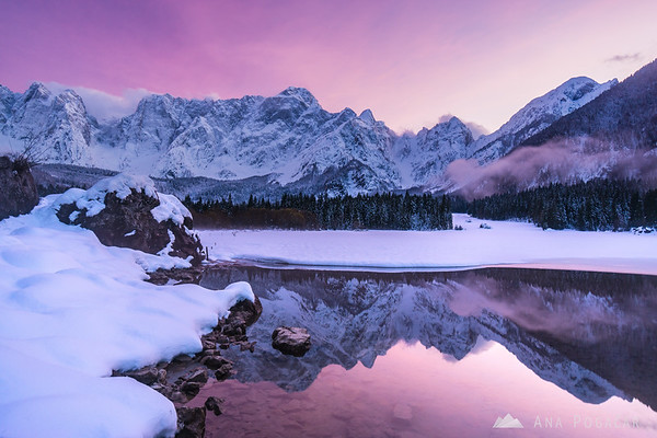 Amazing pink sky after sunset at Mangart Lakes