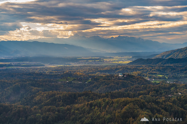 St. Ana church in Tunjice, and the Julian Alps with Mt. Triglav from Špica hill above Kamnik
