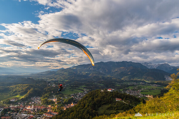 A paraglider taking off from Špica hill above Kamnik