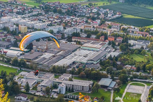 A paraglider descending to Kamnik from Špica hill above Kamnik