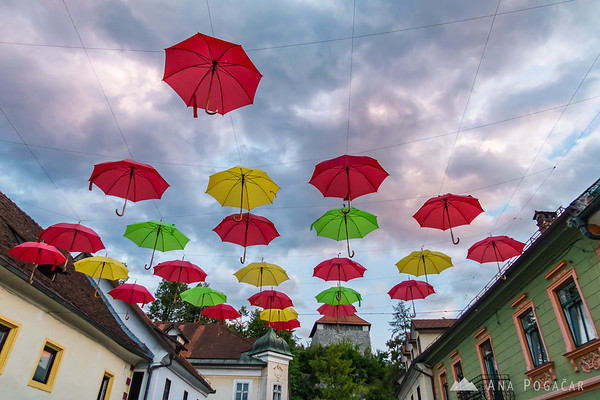 Colorful umbrellas hanging above the main street in Kamnik