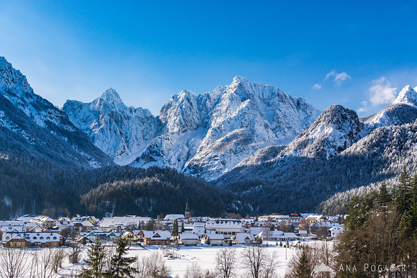 Kranjska Gora and Mts. Razor and Prisojnik in the background