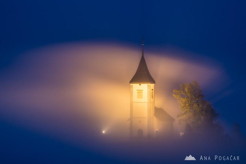 Church in Jamnik during magical foggy blue hour